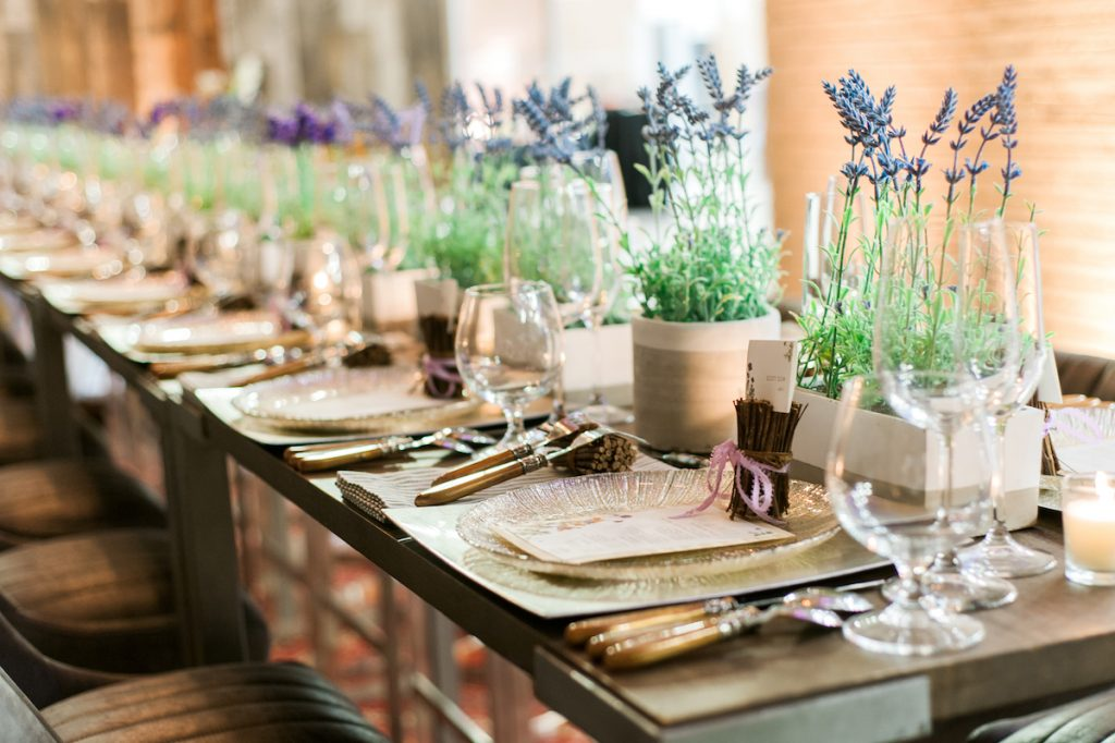 Wedding table with greenery and wood elements