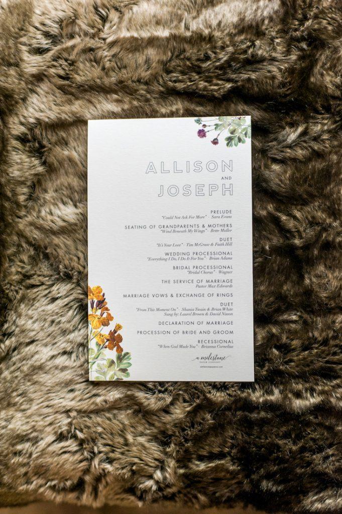White wedding invite with floral design in corners