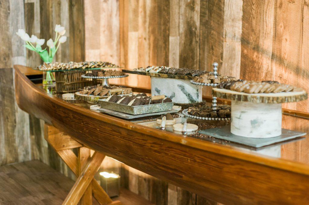 Wedding desserts in canoe
