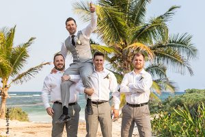 Groomsmen on beach at wedding