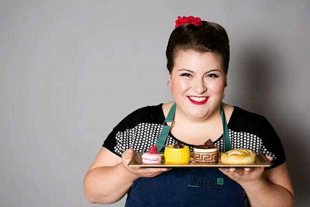 Erin Campbell of Nadia cakes holds a board of sweet treats