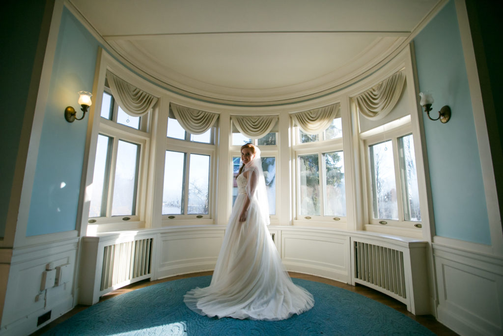 Bride poses for indoor photo
