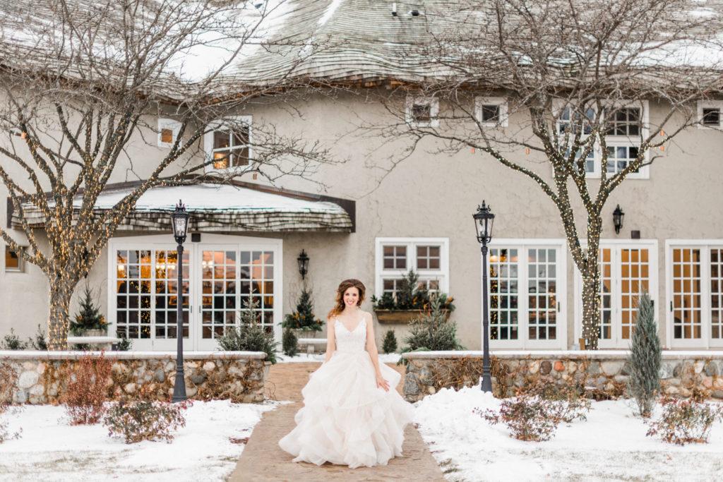Bride walks outside Minnesota wedding venu