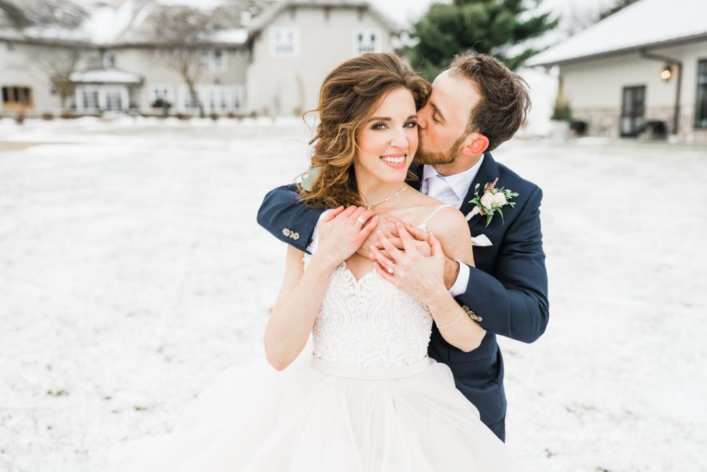 Couple outside at one of the best places to have your winter wedding in Minnesota