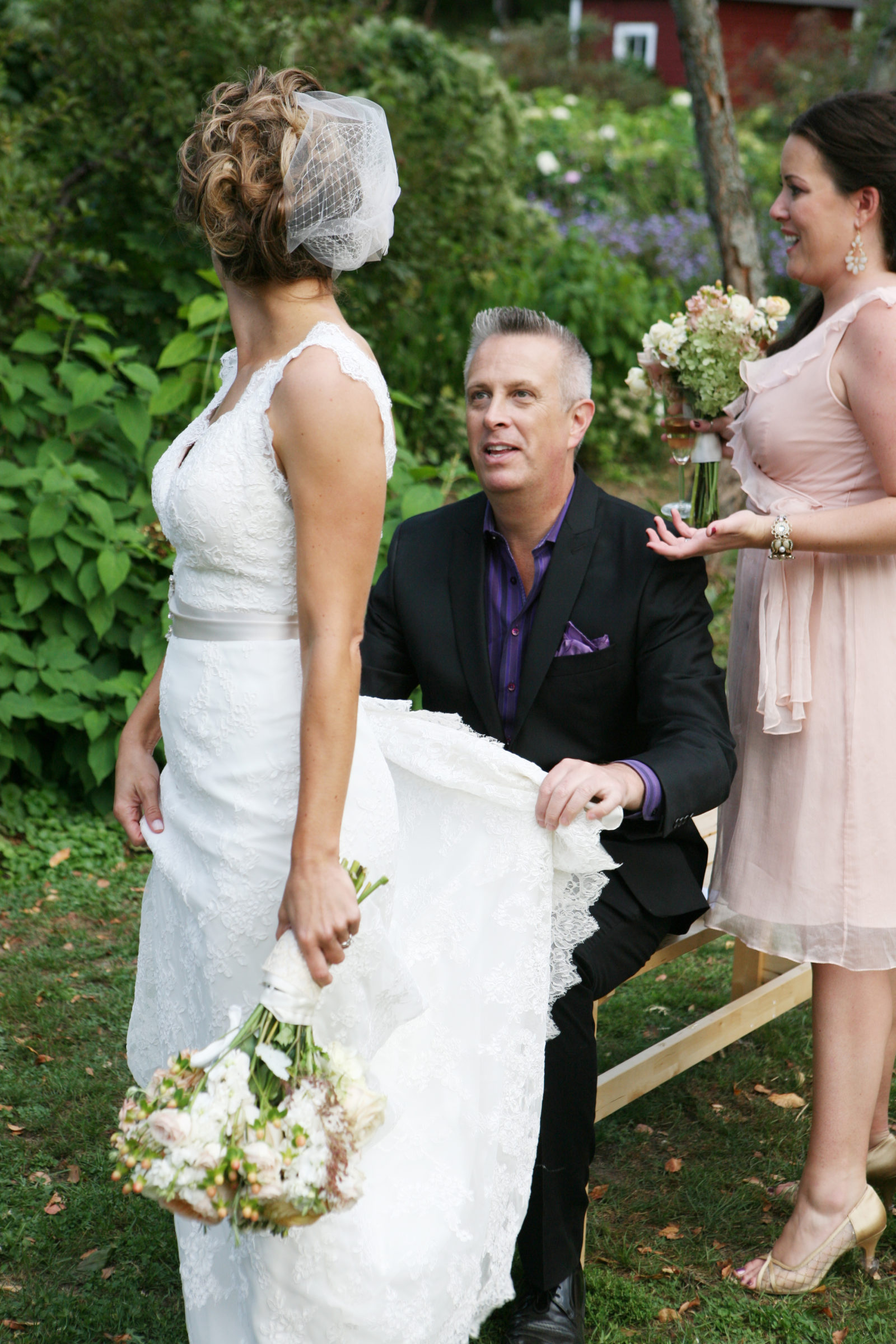 Wedding Guy Bruce Vassar helps bride with dress train