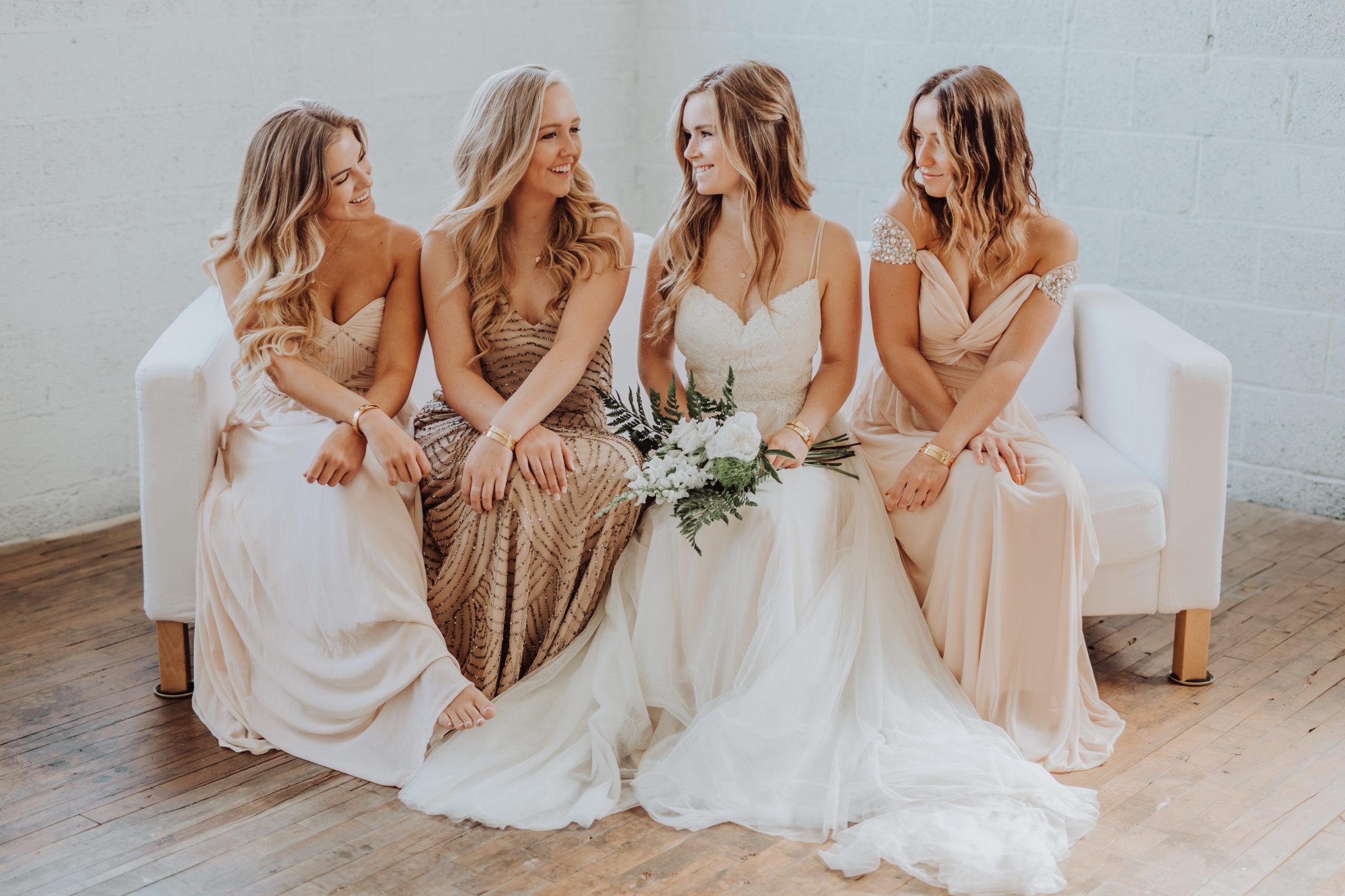 Bridal party in mixed bridesmaid dresses
