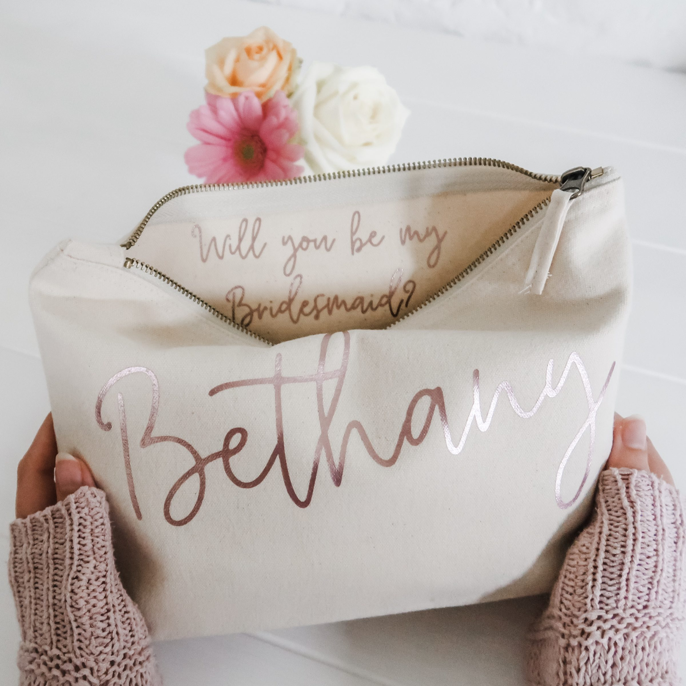 Ways to ask bridesmaids to be in your wedding with a travel bag