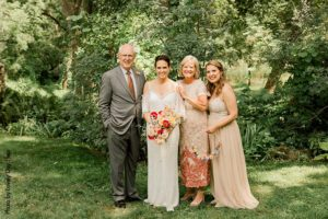 Bride with father, mother, and sister at a Minnesota Wedding