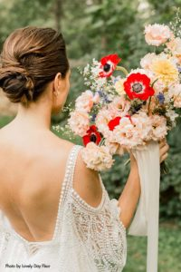 Wildflower bridal bouquet with red anemones