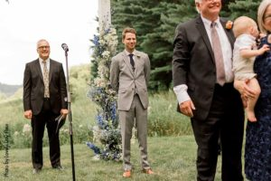 Groom waits for bride during wedding ceremony at Round Barn Farm