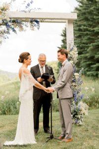 Bride and groom exchange vows at outdoor Minnesota wedding ceremony