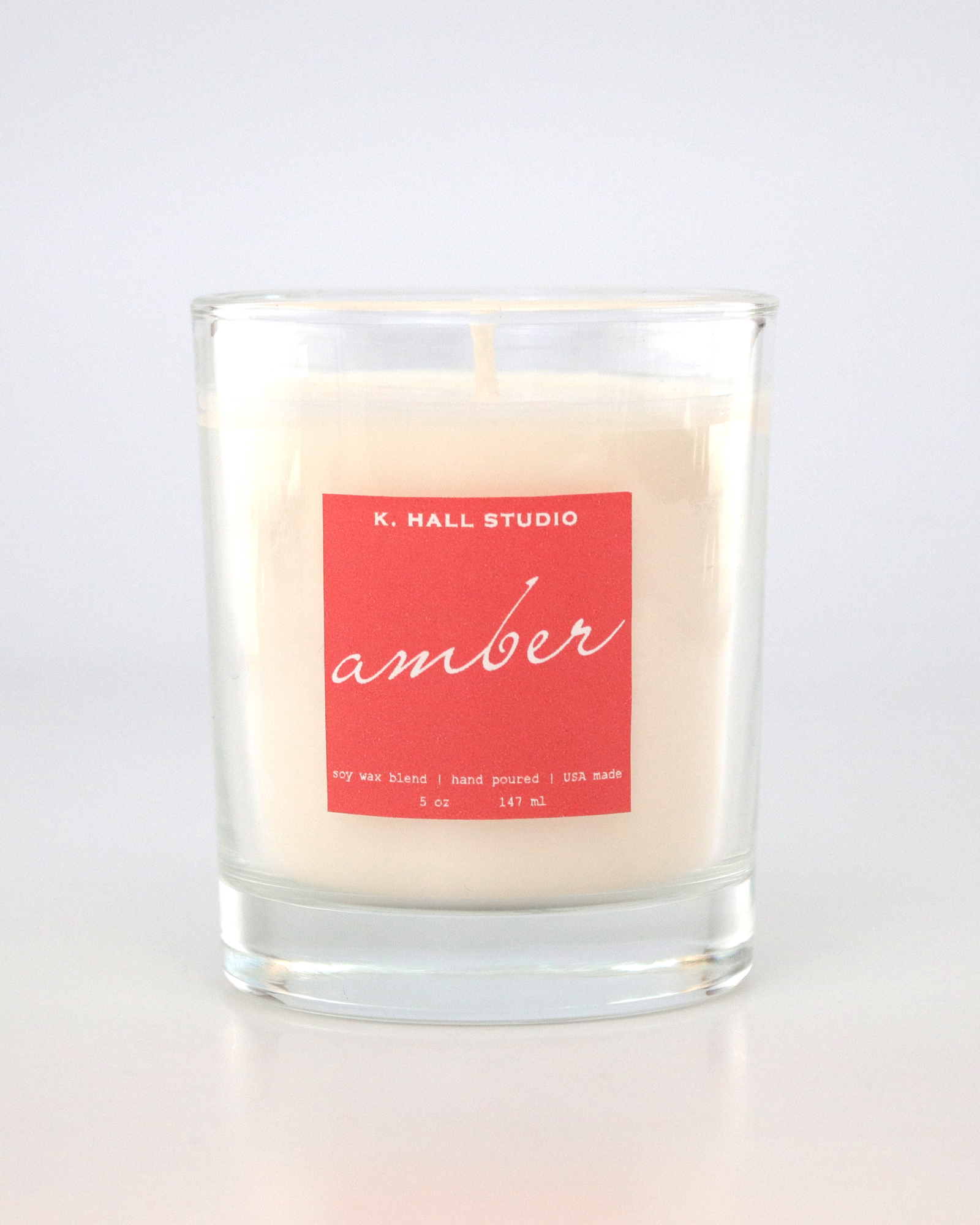 Artisan candle with pink label