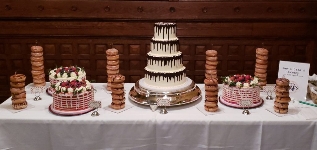 White wedding cake and donut tower