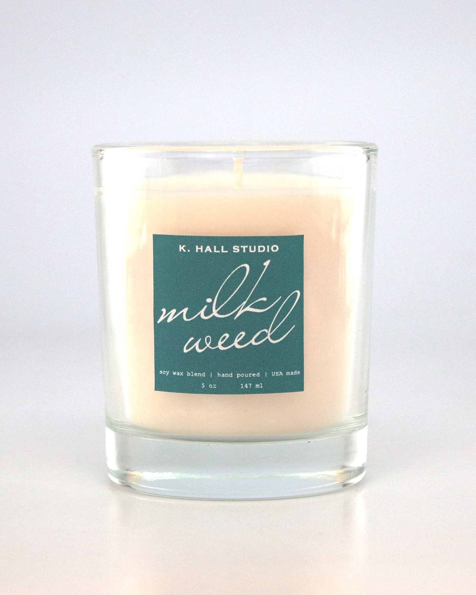 Milkweed candle with dark teal label