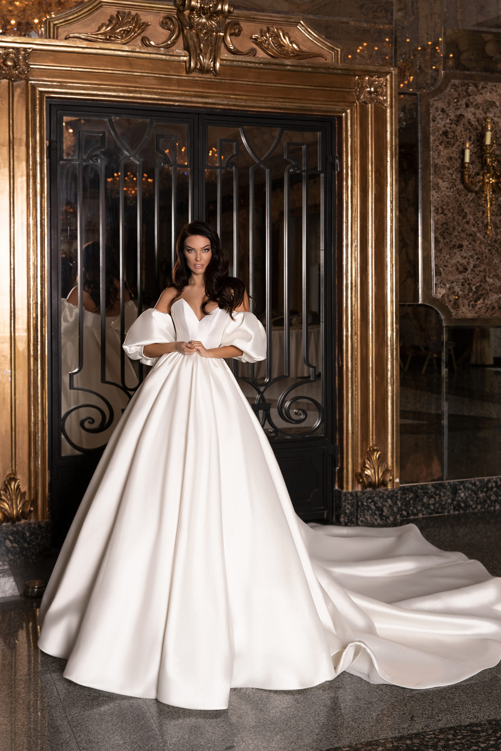Dramatic long train ballgown with large off-the-shoulder sleeves