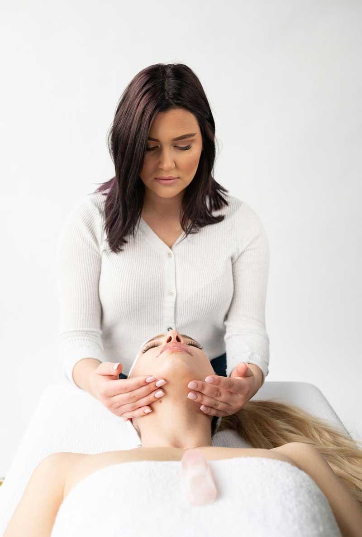 Woman providing facial at spa at Face Foundrié