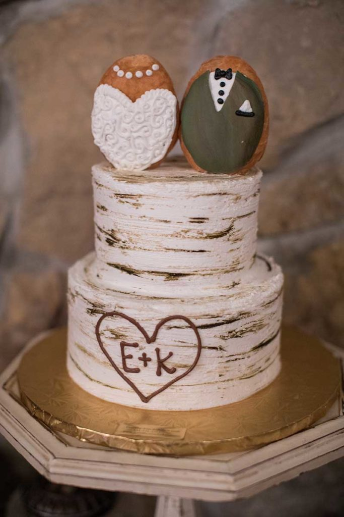 Birch wedding cake with two Mr & Mrs donuts on top
