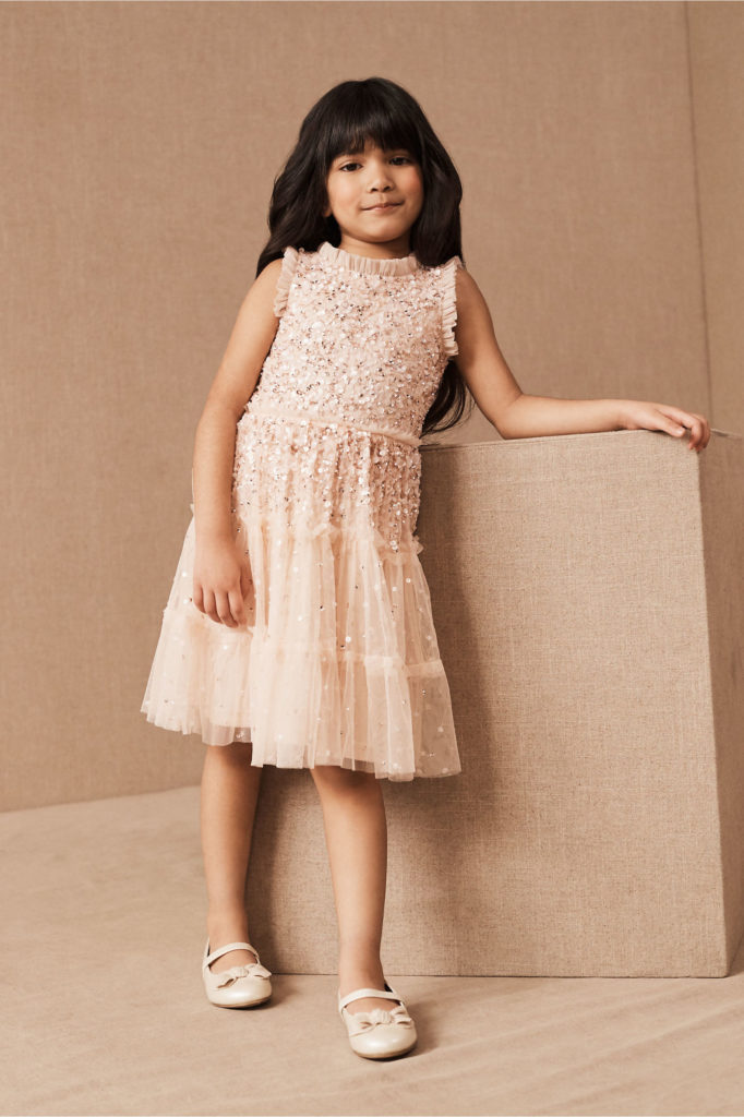 Girl in beaded blush flower girl dress