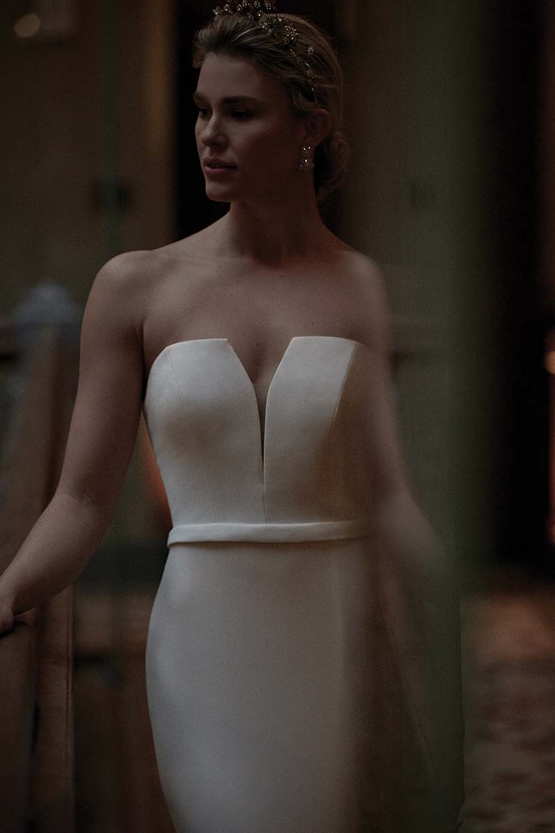 Modern and sleek wedding gown with deep v by Justin Alexander