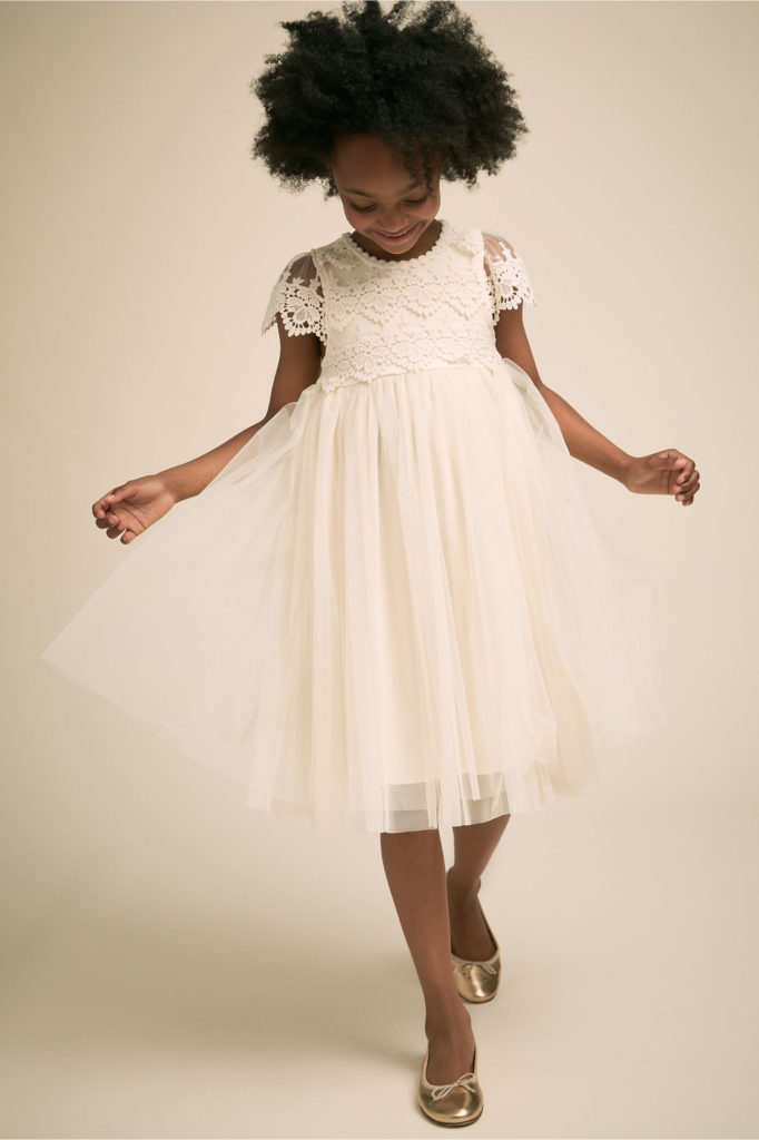 Girl in white flower girl dress