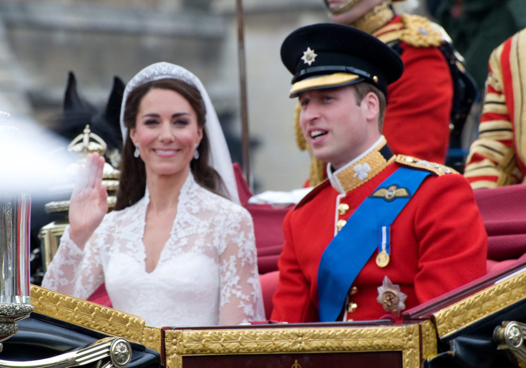 Prince William and Kate Middleton wave to fans post-wedding