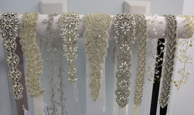 Rhinestone bridal sashes on display
