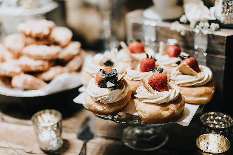 Donuts with fruit on top at wedding