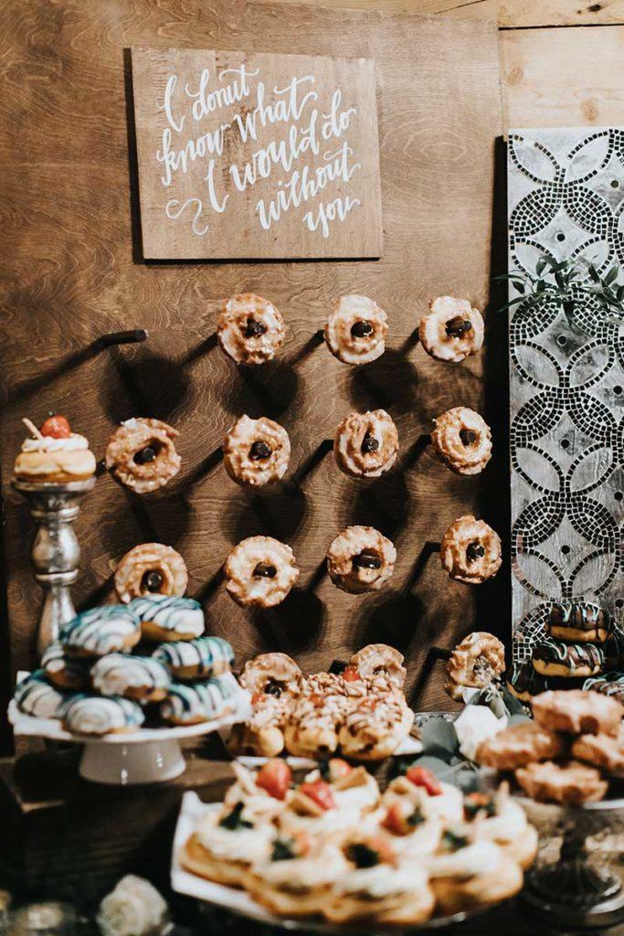 Donut wall at wedding dessert table