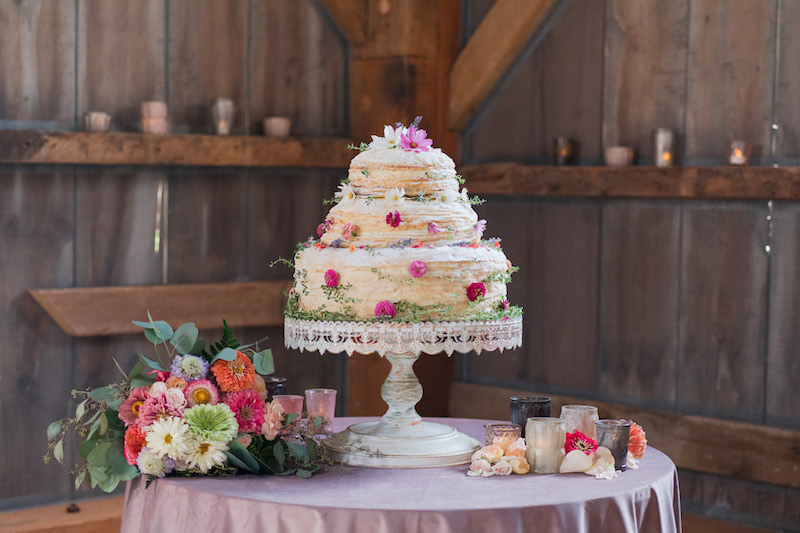 3-tier spring wedding cake with floral additions