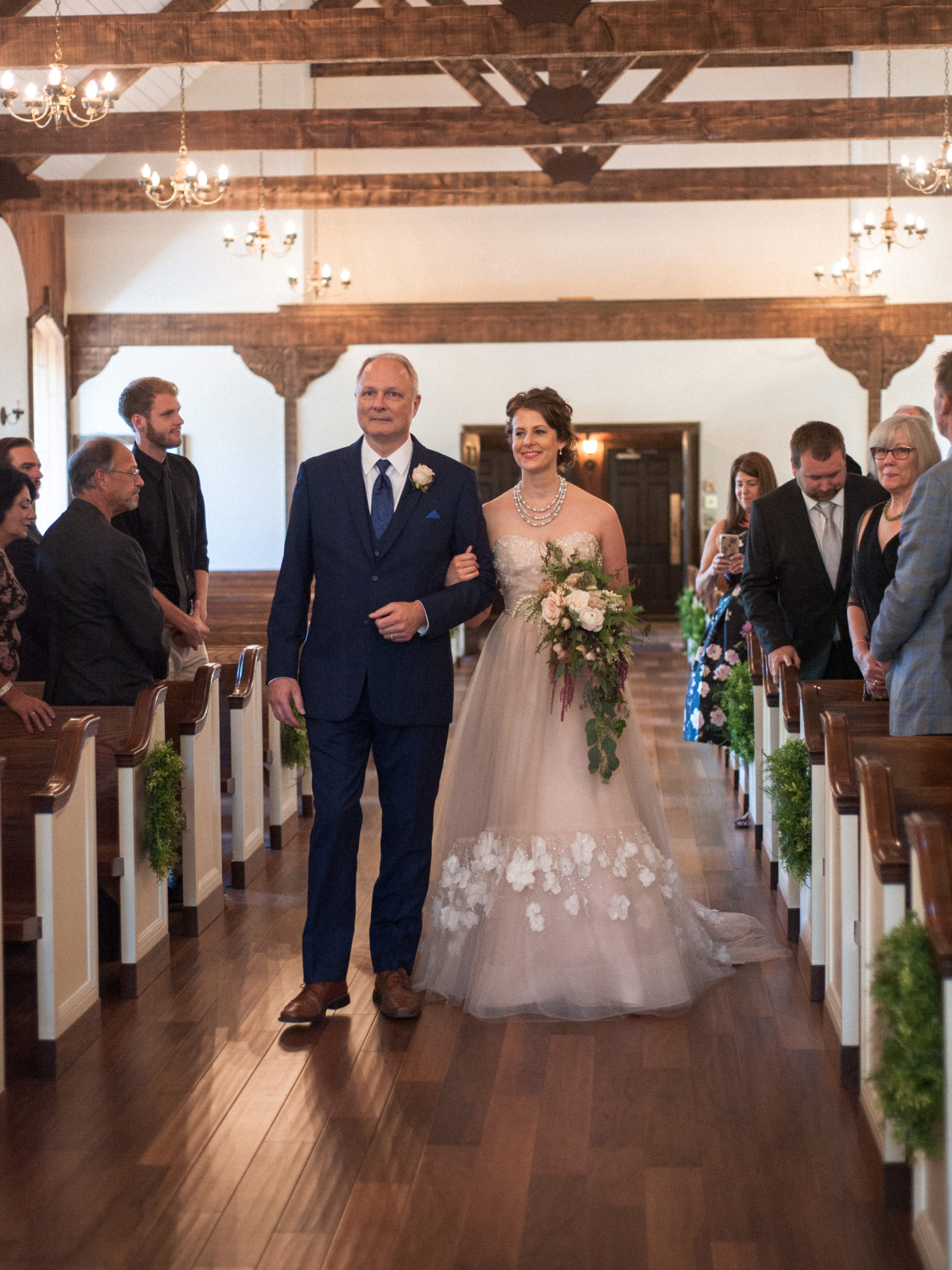 Bride is walked down the aisle by her step-dad