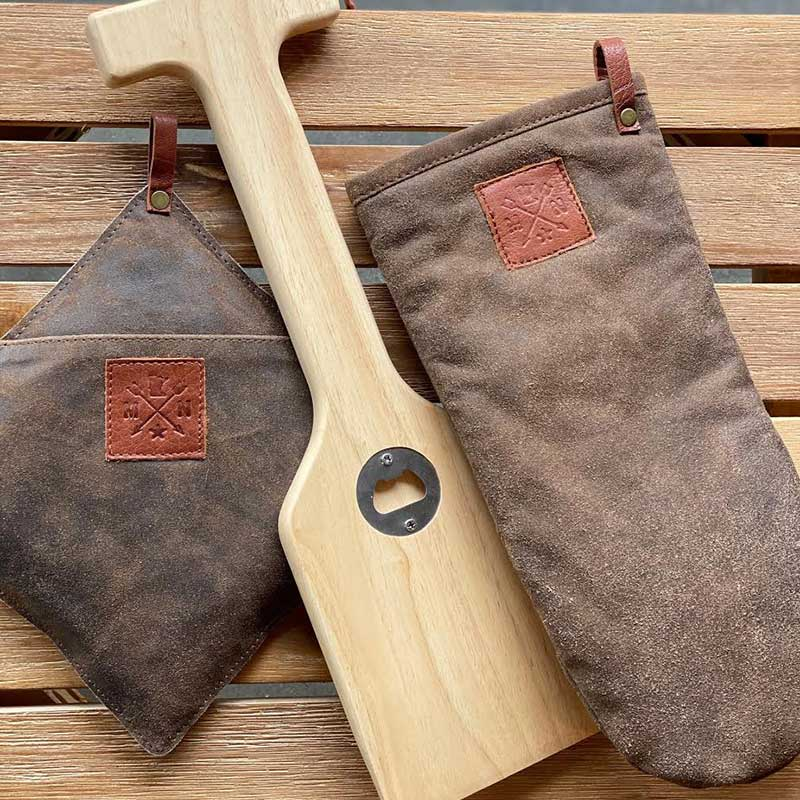 Grill scrapper and brown oven mitts