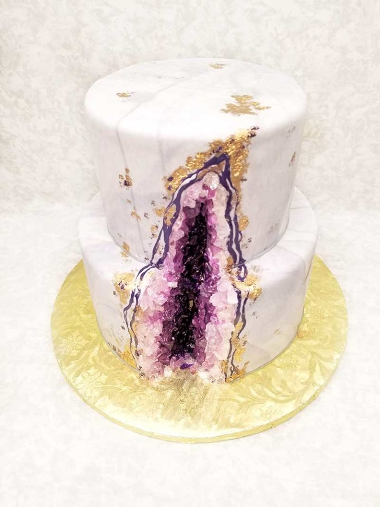 Purple, pink, and white geode wedding cake