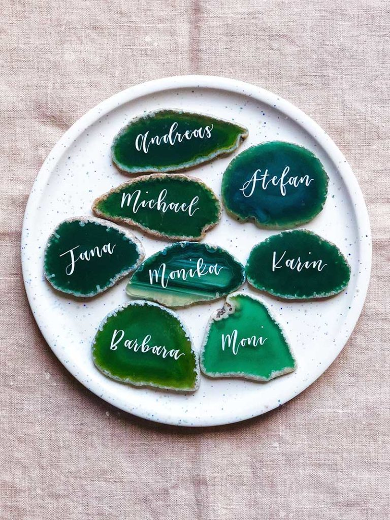 Green geode coasters with hand-written calligraphy