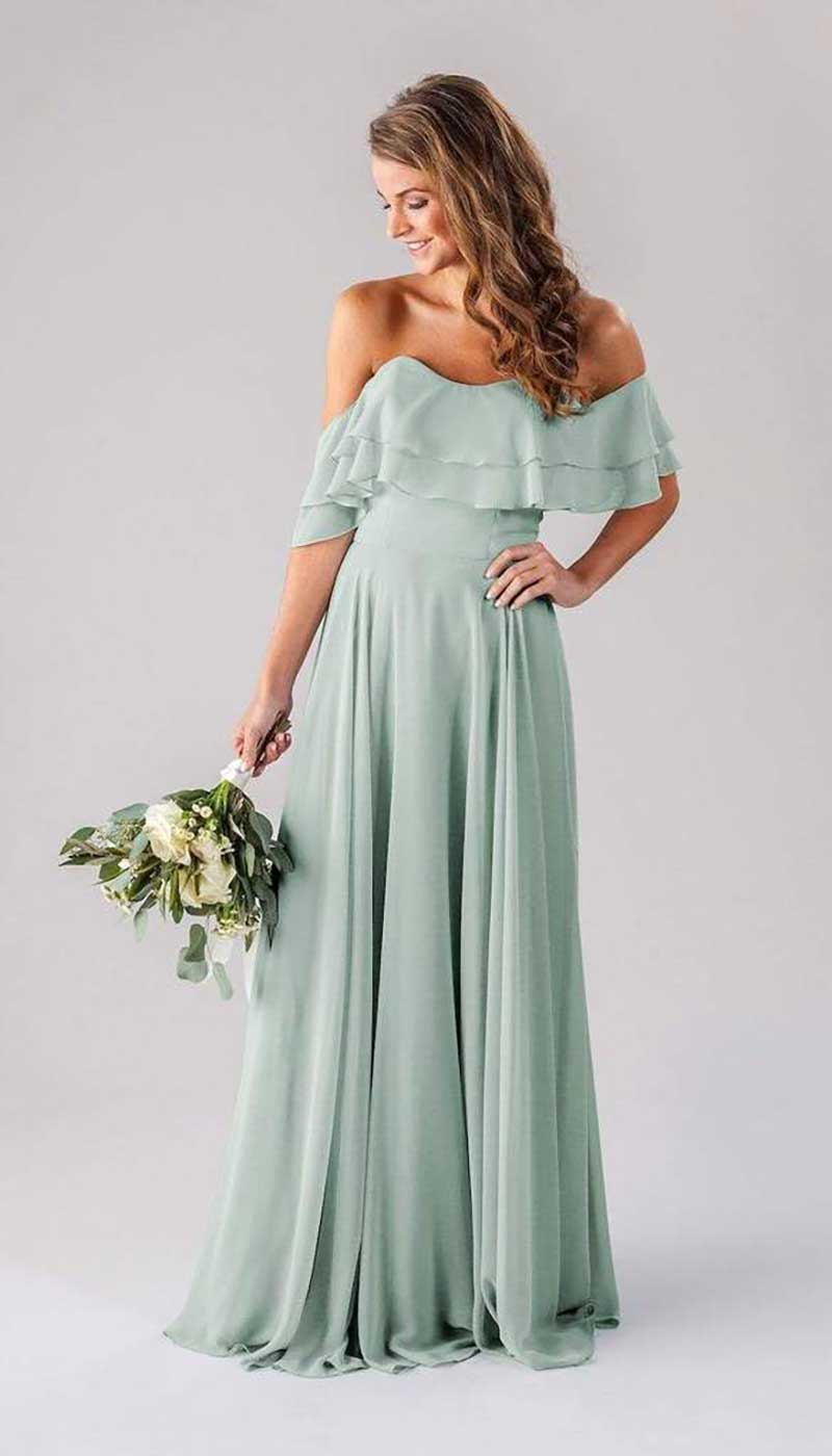 Woman in mint colored bridesmaid dress by Kennedy Blue