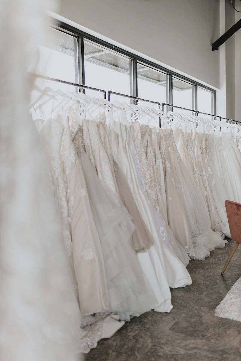 Wedding gowns on rack at Luxe Bridal Couture in Rochester