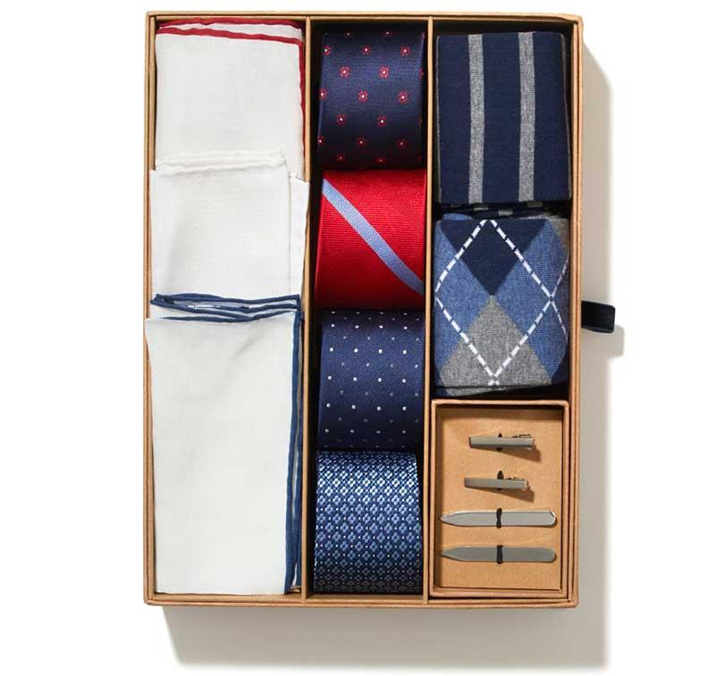 Tie box with ties, socks, tie bars