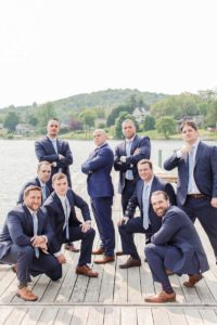 Groom and groomsmen in blue sets pose for photo