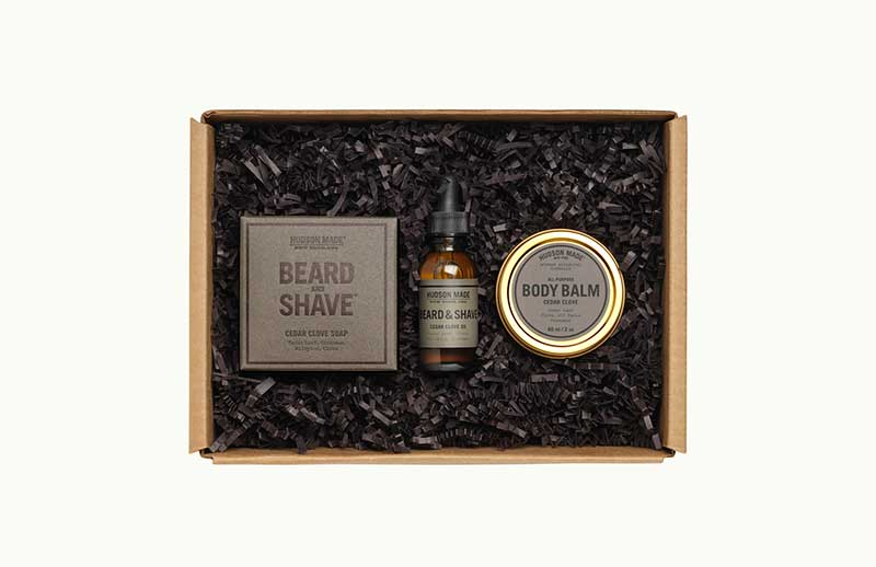 Box with beard oil, bodu balm, and soap by Barber Box