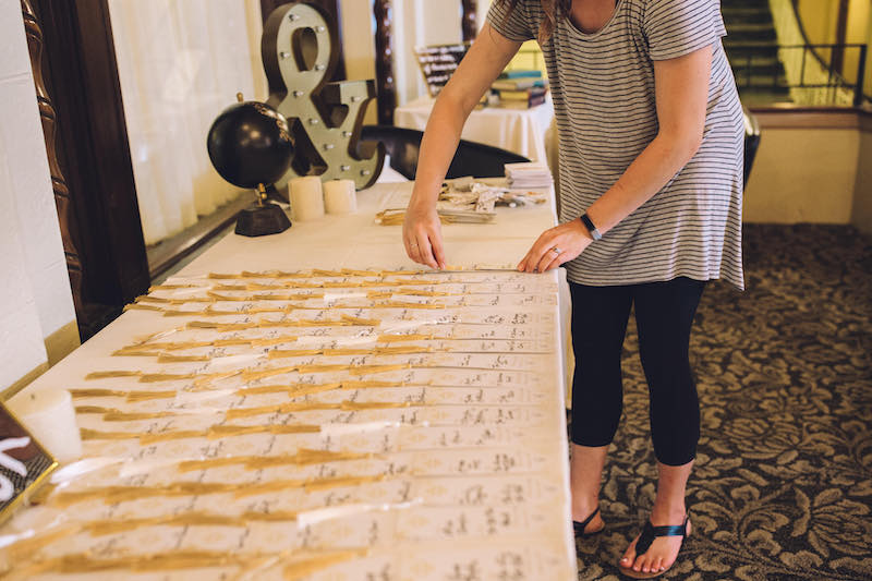 Woman sets up table numbers at wedding