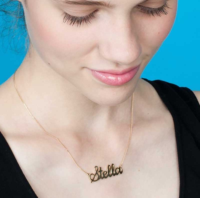 Girl wearing nameplate necklace