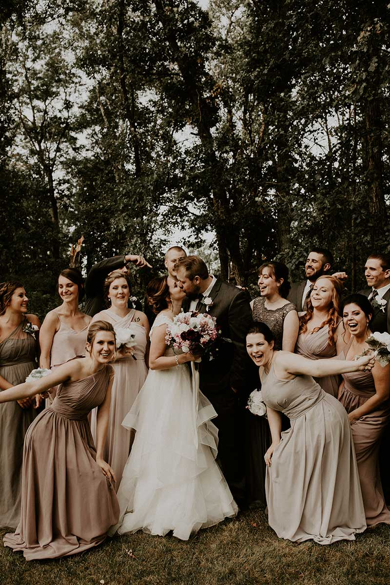 Wedding party in mauve and tan dresses celebrate wedding by Gypsy Hair Guru
