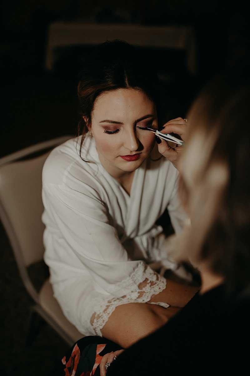Bride getting wedding hair and bridal makeup done by Gypsy Hair Guru