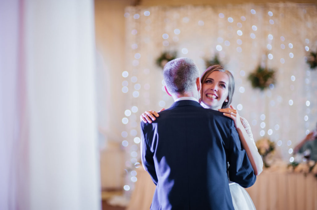 Bride include your stepdad in your wedding by sharing a dance