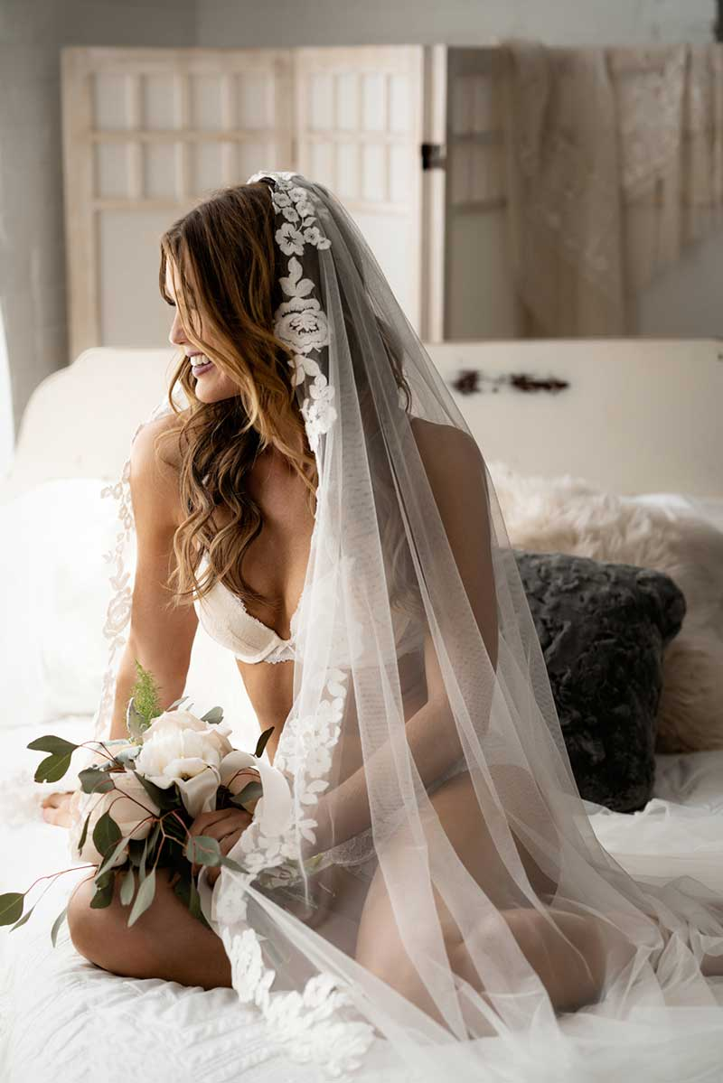 Bride in lingerie and long veil at 4 Girls Glamour boudoir photography shoot