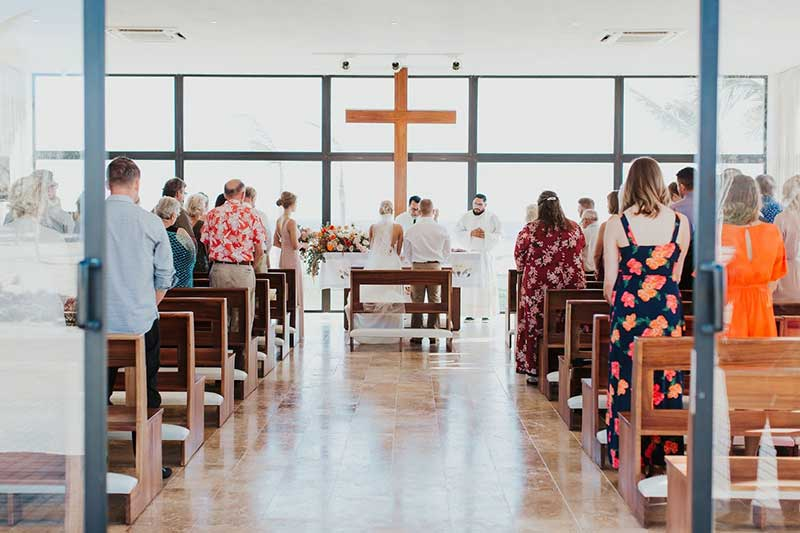 Couples marries in a church for destination wedding
