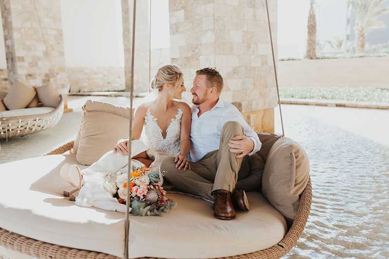 Couple on swing after destination wedding ceremony