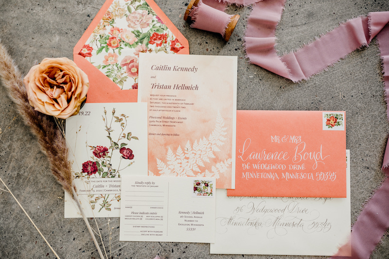 Coral and ivory floral wedding invitations with hand-written calligraphy from Epitome Papers