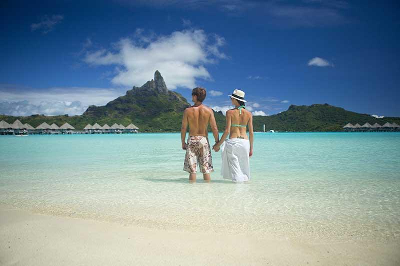 Couple on beach in Bora Bora