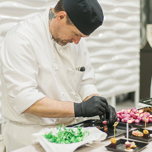 Chef prepares food for Tasting Bar at Unveiled Minneapolis