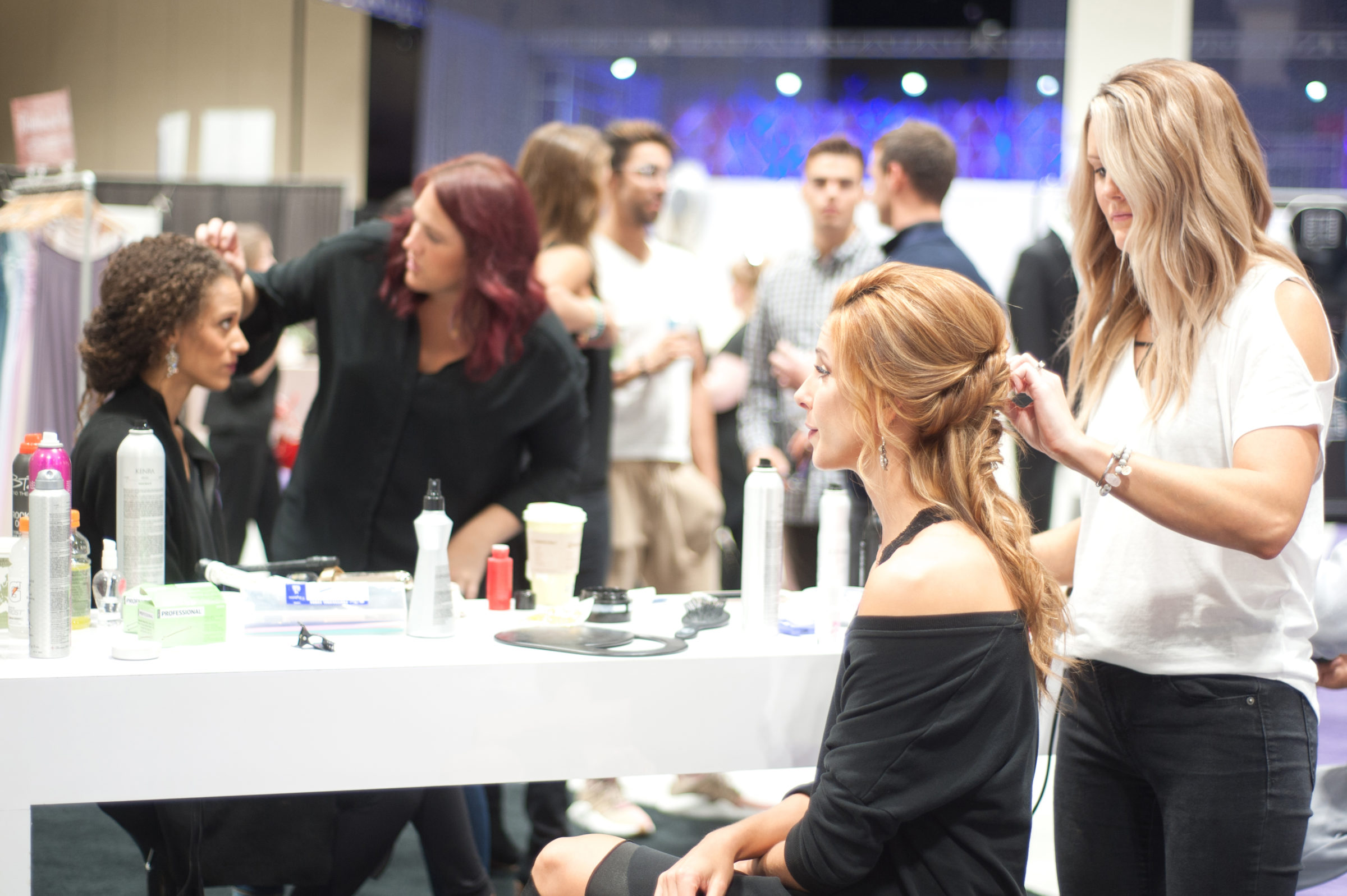 Model gets makeup done at Glam2Go Makeover Zone